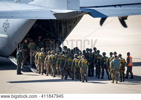 Paratroopers Entering A Us Air Force C-130 Hercules Transport Plane On Eindhoven Airbase. The Nether