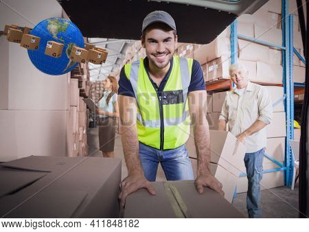 Composition of globe and cardboard boxes with warehouse worker leaning on box in warehouse. moving house, global shipment and delivery concept digitally generated image.