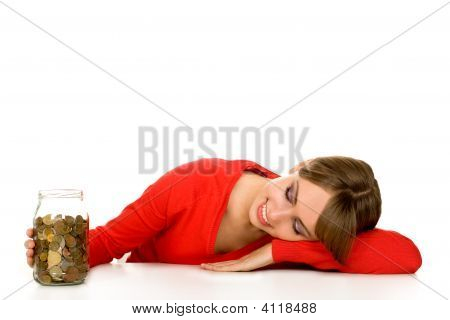 Woman Looking At Coins In Jar