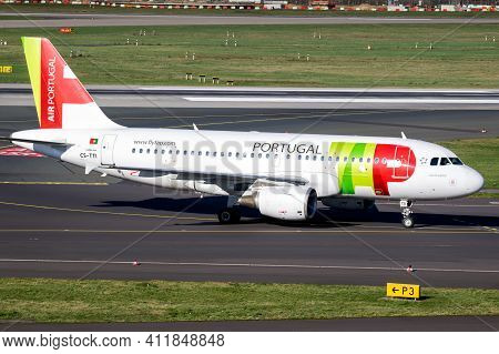Airbus A319 Airplane From Tap Air Portugal Airlines Taxiing To The Gate After Landing On Dusseldorf