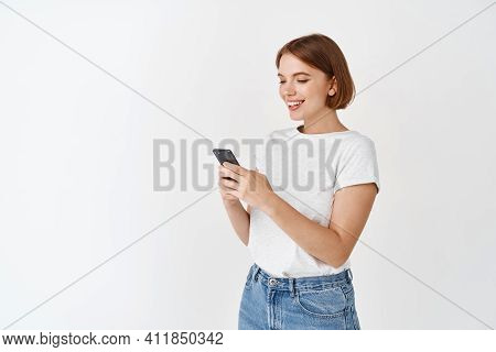 Portrait Of Smiling Woman Texting Message, Reading Phone Screen. Happy Woman Chatting On App, Standi