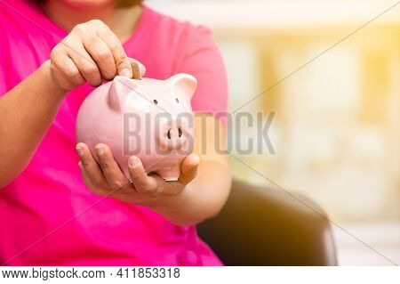 Concept Business Woman Hand Putting Money Coin Into Piggy Bank Saving Money For Future Plan And Reti