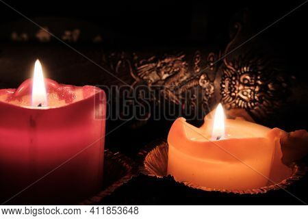 Candlelight Illuminates The Scabbard Of The Ancient Shaolin Chinese Sword. Selected Focus