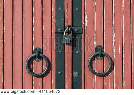 Padlocked Wooden Doors Of The Red Gate Close Up