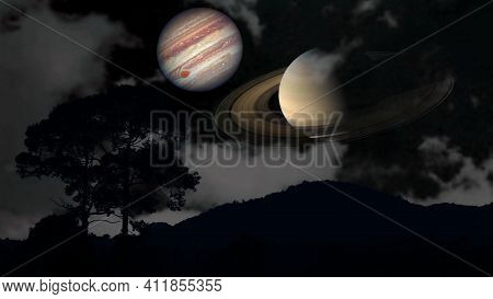 Saturn And Jupiter Rise Back Silhouette Mountain And Cloud On The Night Sky