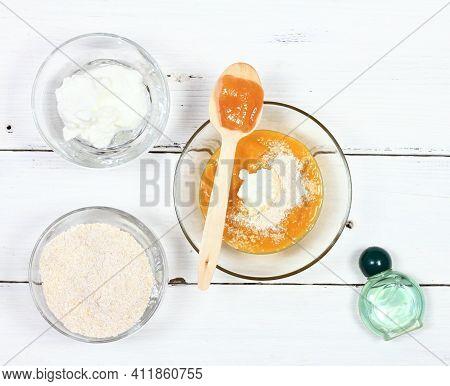 Homemade Face Mask From Mango, Heavy Cream, Finely Ground Oats And Honey. Three Bowls Full Of Food I