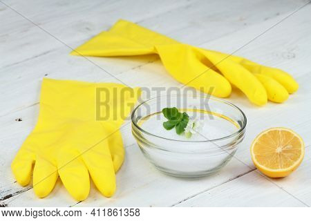 Crystalline Citric Acid In A Bowl, Good For Cleaning. Rubber Gloves And Lemon Cut In Half On The Whi