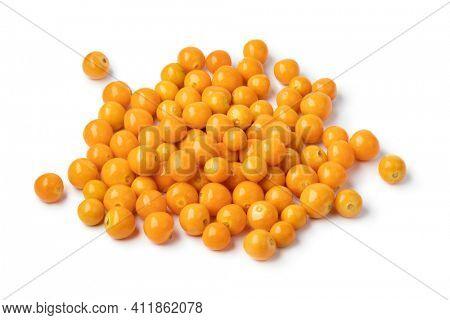 Heap of fresh orange goldenberries close up isolated on white background