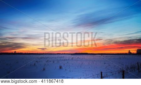 Beautiful Snowy Winter Landscape Panorama With Agricultural Field And Sun. Winter Sunset In A Panora