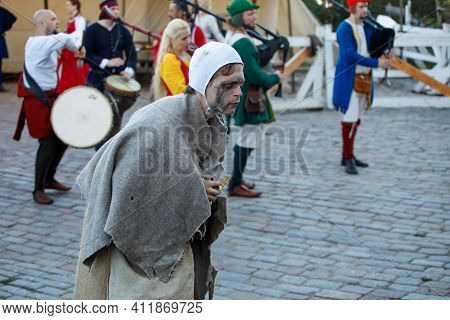 Russia. Vyborg. 08.20.2020 Theatrical Performance In The Castle. Actor In A Beggar Costume.