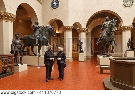 Moscow, Russia - January 26, 2021: People wearing protection mask in Pushkin Museum of Fine Arts is largest museum of Europe art in Moscow. Greek hall