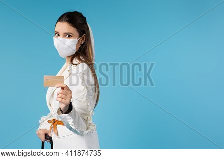 Female Executive Showing A Blank Credit Card, Wearing A Face Mask And Formal Wear. Side Space For Te