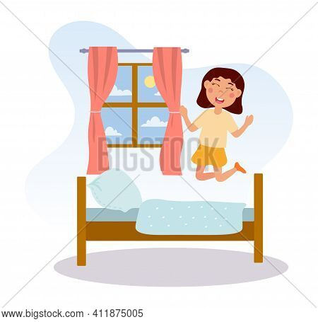 Little Happy Girl Is Jumping On Bed. Cute Child In Bed In Her Room With Window On The Background. Ki