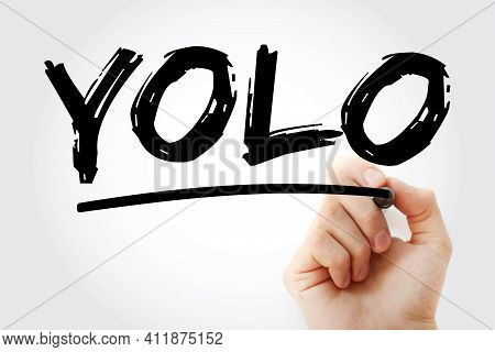 Yolo - You Only Live Once Acronym With Marker, Concept Background