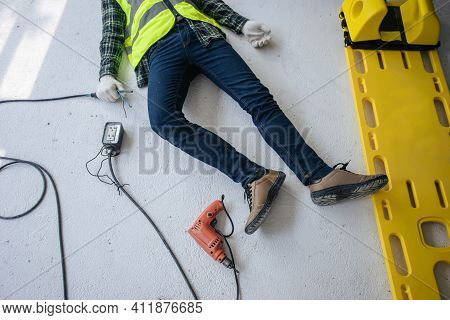 Accident Electrocuted, Unconscious Electrician Worker Lying On The Floor With Stretcher Of Paramedic