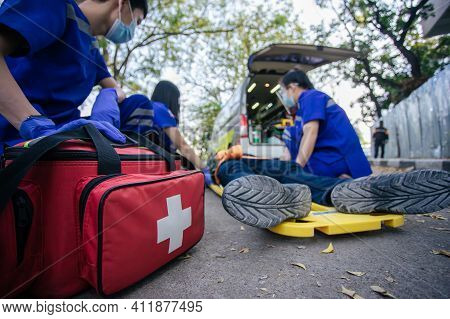 Selective Focus Is First Aid Bag. Team Paramedic Firs Aid Accident On Road. Ambulance Emergency Serv