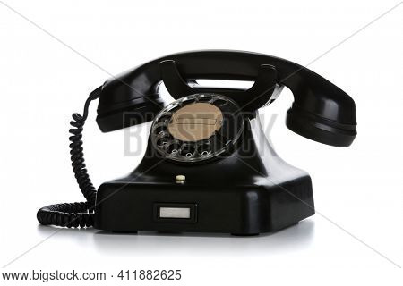 Vintage black bakelite telephone isolated on white background