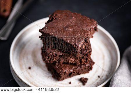Chocolate Brownies Stack On A Plate. Rich Dark Chocolate Brownies