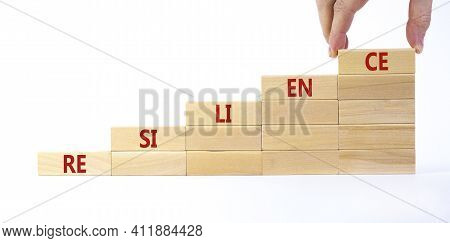 Resilience Symbol. Wooden Blocks With Word 'resilience' Stacking As Step Stair On Beautiful White Ba