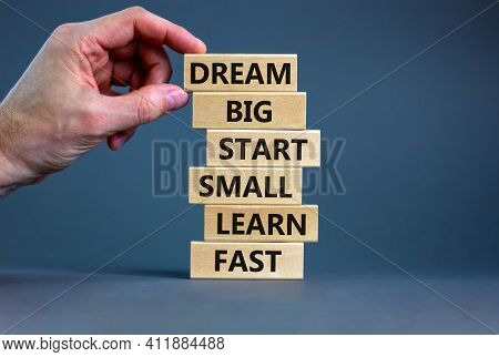 Dream Big Start Small Symbol. Words 'dream Big Start Small Learn Fast' On Wooden Blocks On A Beautif