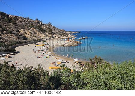 Konnos Beach, Cyprus - May 15, 2014: People Relax At Konnos Beach In Cyprus. Tourism Makes About 10