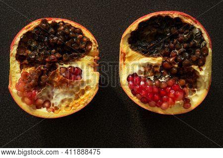 Cut Pomegranate Fruit, Half Rot. Flat Lay