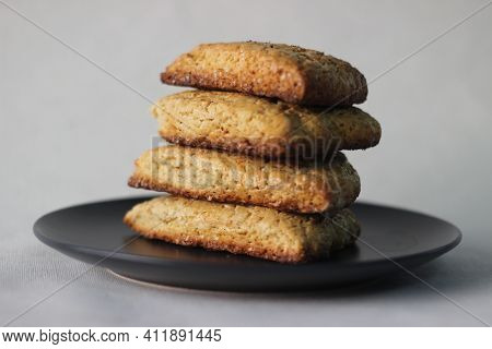 Home Baked Plain Mildly Sweet Buttermilk Scones, Four Of Them Stacked On A Grey Plate.