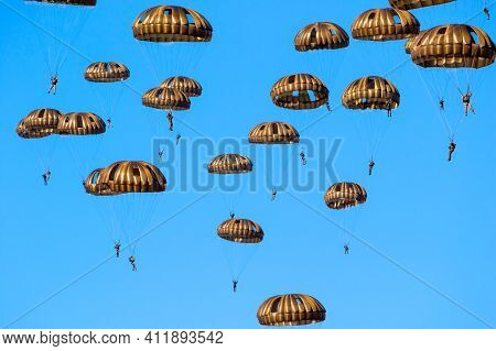 Ede, Netherlands - Sep 21, 2019: Group Of Military Parachutist Paratroopers In The Sky During The Op