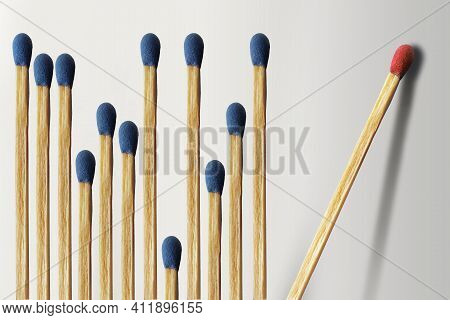 Wooden Matches Are Lined Up With A Dozen Blue Matches On The Left And One Red Match Isolated And Alo