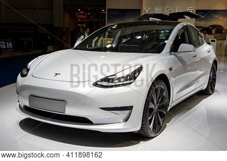 Brussels - Jan 9, 2020: New Tesla Model 3 Electric Car Presented At The Brussels Autosalon 2020 Moto