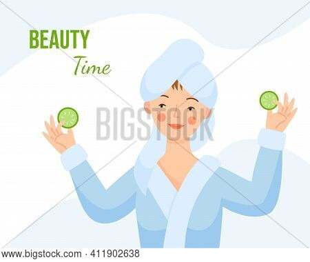 A Girl In A Dressing Gown With A Towel On Her Head Makes A Mask With Cucumbers. The Girl Holds Cucum