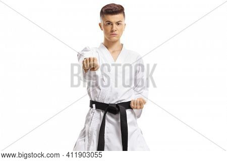 Full length portrait of a teenage boy exercising karate kata isolated on white background