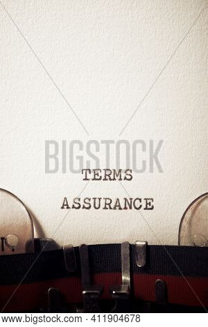Terms assurance phrase written with a typewriter.