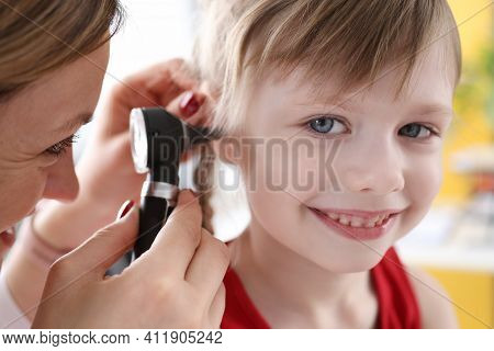 Little Child With Doctor Exam Hearing Deviation Against Office Background Portrait. Ent Otitis Treat
