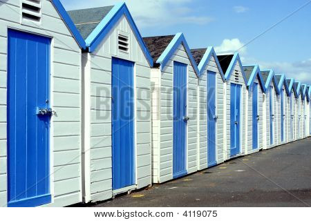 Row of Beach Huts on Seafront at Hove / Brighton East Sussex. England poster