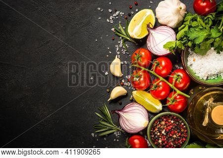 Food Cooking Background On Black Stone Table. Fresh Vegetables, Herbs. Ingredients For Cooking. Top