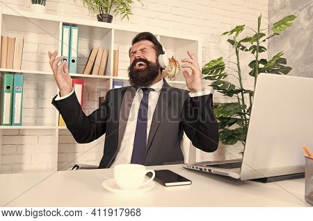Music For Stress Relief. Businessman Enjoy Music In Office. Bearded Man Listen To Music And Sing Alo