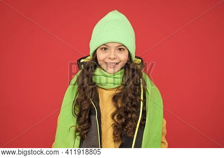 Comfy Winter Wear For Young Explorer. Happy Child With Winter Look Red Background. Small Child Wear