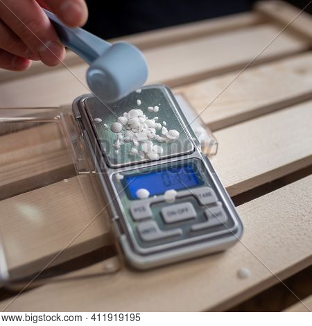 The Drugs Are Heroin Or Cocaine In The Form Of A White Powder. Small Scales For Weighing Drugs.