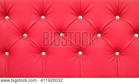 Stylish Red Soft Leather Upholstery Of Sofa. The Material Is Decorated With Buttons In The Form Of C