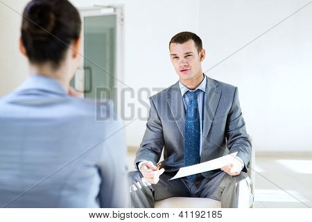 Businessman talking to a woman for a job
