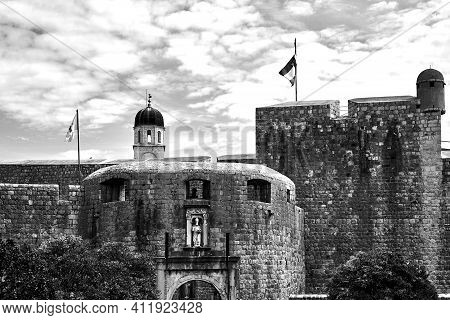 Medieval Gate And Ramparts In The City Of Dubrovnik In Croatia, Monochrome