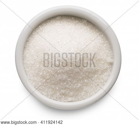 White refined sugar in ceramic bowl on white background. Top view. File contains clipping path.