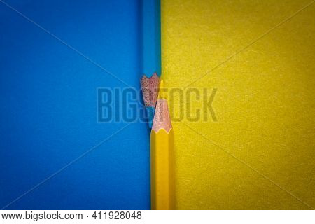 Same Color Pencils On Two Color Background. Two Pencils Of The Same Shades Of Two-color Background P