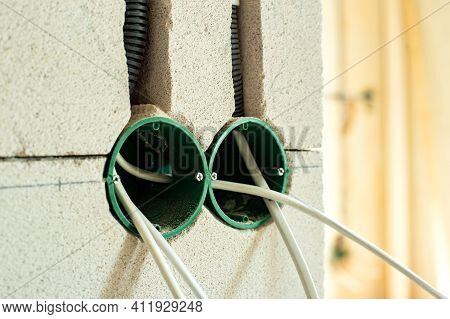 New Electrical Wiring Installation, Plastic Boxes And Electrical Cables For Future Outlet Sockets On