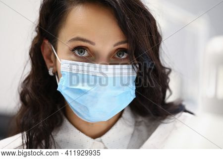 Portrait Of Female Client Wearing Protective Face Mask. Prevention Virus Spread. Brunette Serious Wo