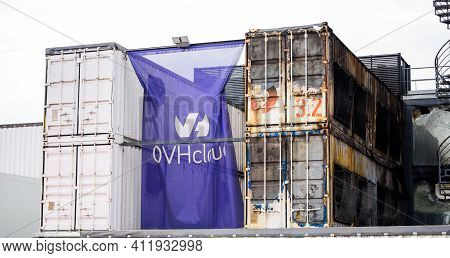 Strasbourg, France - Mar 10, 2021: Waving Flag With Insignia And Burnt Remains Of The Large Data Cen