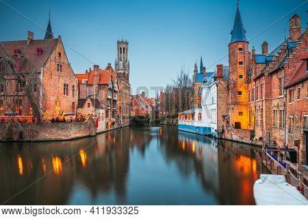 Bruges, Belgium night scene on the Rozenhoedkaai River.