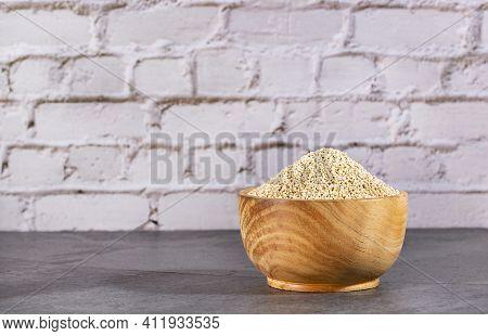 Chenopodium Quinoa - Organic Quinoa Seeds In The Wooden Bowl