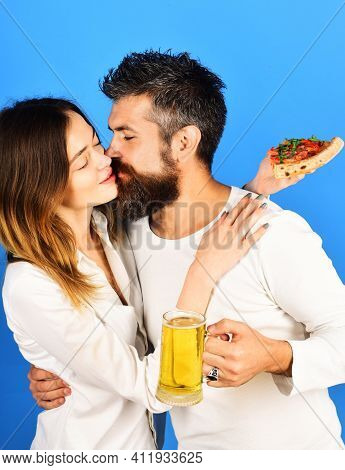 Beautiful Couple Drinking Beer And Eating Pizza. Happy Family Time. Husband And Wife Eating Pizza. L